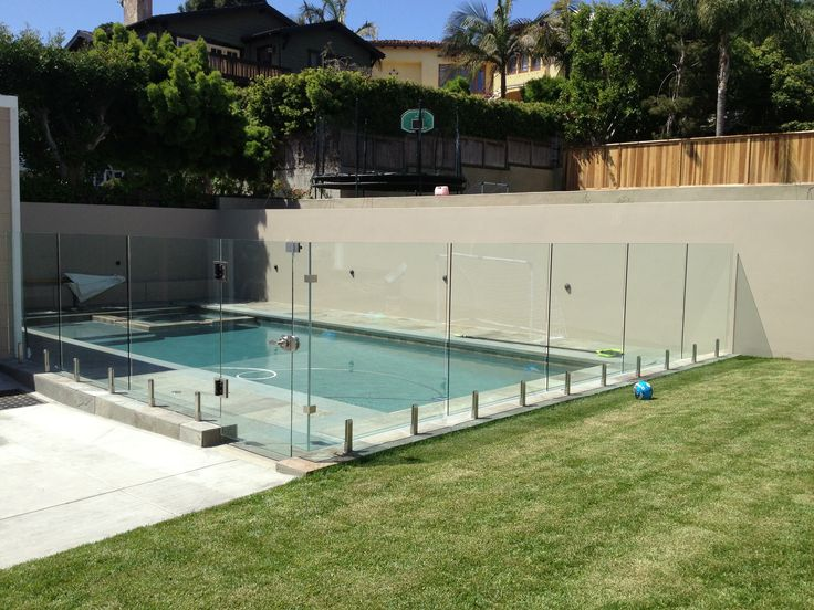 I've been thinking that it would be cool to have glass railing for the stairs in my house. However, I think I like it better around the pool. I'm also pretty sure my husband would like the idea since he's been talking about how our pool needs some kind of fence around it.