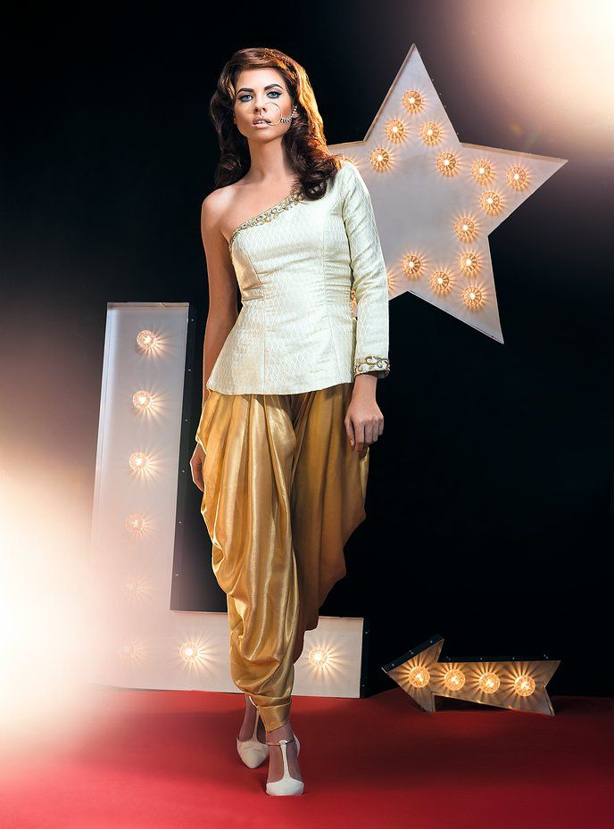 One shoulder gold brocade top with dhoti. www.puneetbhandal.com