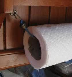 Paper towel holder - bungee cord!.... Great for outdoors or garage!