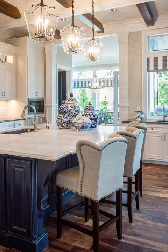 Traditional white kitchen with dark island