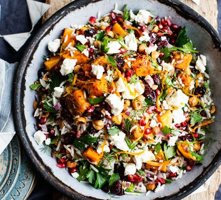 This vibrant Persian side salad is studded with dried fruit, nuts and seeds and finished with crumbled feta - ideal for a healthy snack.