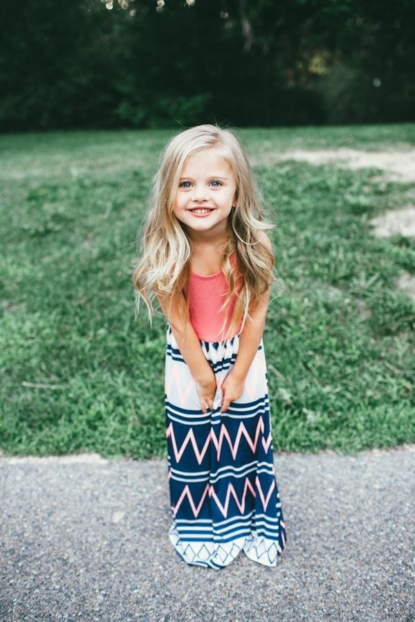 Our popular Neon & Navy Chevron Maxi Dress is BACK! Maxi dresses are floor length with no sleeves (perfect for summer days). Dress features top solid color with bottom print. Made with ultra-soft, lightweight material.