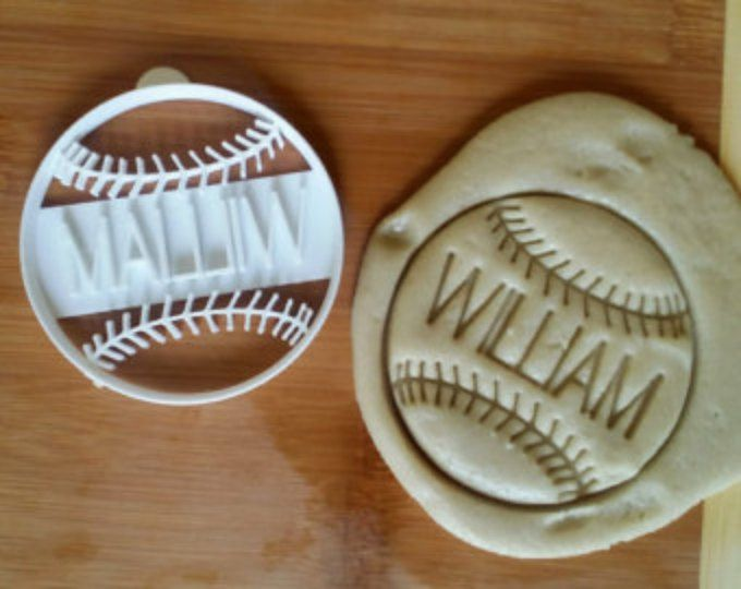 This baseball (or softball) cookie cutter stamps and cuts in one press! Includes a tab on the side to help lift it. This would be perfect for a team party, fundraiser bake sale, or sports themed birthday party.  This cookie cutter is a 3 inch circle.  If you would like custom text included on this cookie cutter: http://etsy.me/1I0mW78  Each one of our cookie cutters is custom made from white PLA plastic, which is biodegradable and made from corn. PLA is categorized by the US Fo...