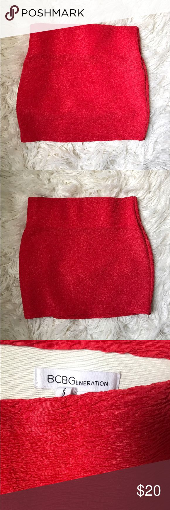 "BCBGeneration Stretch Pullover Mini Skirt Size S BCBGeneration Stretch Mini Skirt in a beautiful cranberry color.  In excellent condition.  	•	Size: Small 	•	Banded waistline 	•	Length: 15.5"" 	•	Waist: 28"" 	•	Fabric: 100% polyester 	•	Care: Machine wash cold BCBGeneration Skirts Mini"