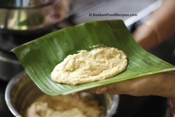 Jackfruit Idli in the making. A ladle of batter is spread on a banana leaf & is steamed to make delicious sweet jackfruit idlis. They're called ponsa idli in Konkani. Recipe from KonkaniFoodRecipes.com