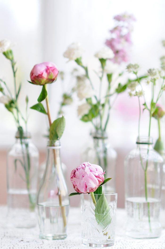 Simple vases with flower stems. Very nice in groupings. I have lots of bottles. Both clear and painted. Nancy
