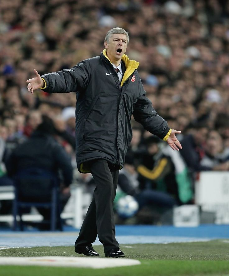 Arsene Wenger, the Arsenal manager, shouts instructions during the UEFA Champions League Round of 16, First Leg match between Real Madrid and Arsenal at the Santiago Bernabeu Stadium on February 21, 2006 in Madrid, Spain. (Feb. 20, 2006 - Source: Getty Images Europe)