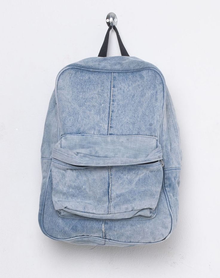 Classic shape large denim rucksack with full zip, front zip pocket and adjustable straps.   Featuring awesome printed vintage fabric lining and small zipped inner pocket.  Created using fabric from vintage denim jackets and jeans!  ONE SIZE - Height: 42cm   Width: 28cm  Depth: 13cm
