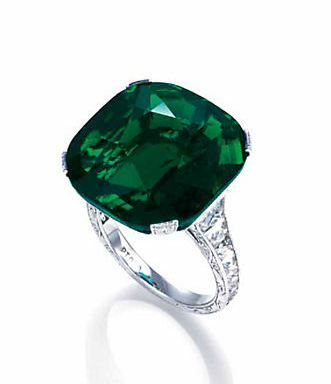 The Crown of Columbia - a rare emerald and diamond ring, set with a cushion shaped emerald weighing about 15.99 carats, mounted in platinum.