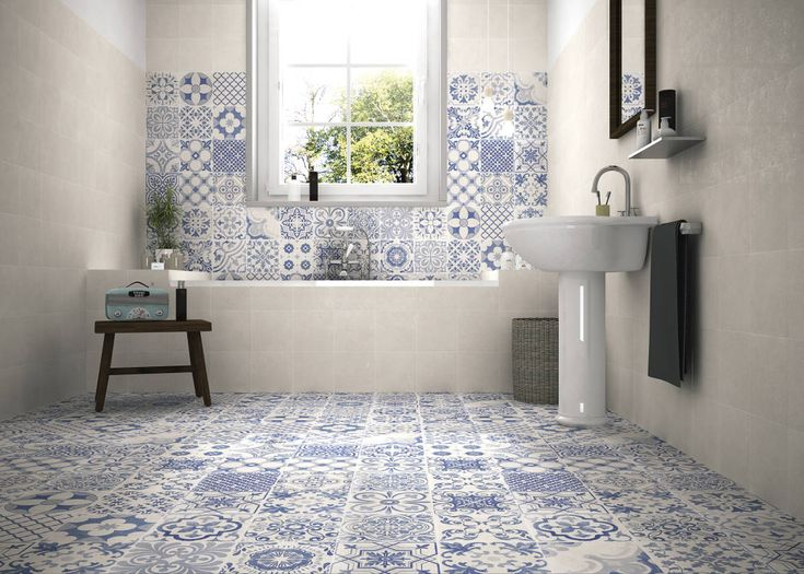 This modern bathroom with blue and white tiles is absolutely lush. PATCHWORK TONOS AZULES : by Gama Ceramica y Baño