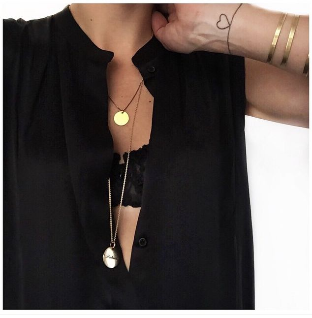 Black button up with black lace bra and simple gold necklace
