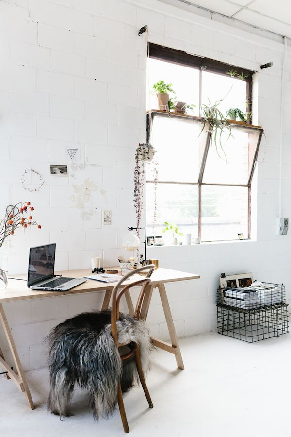 Desk in bright white home office.