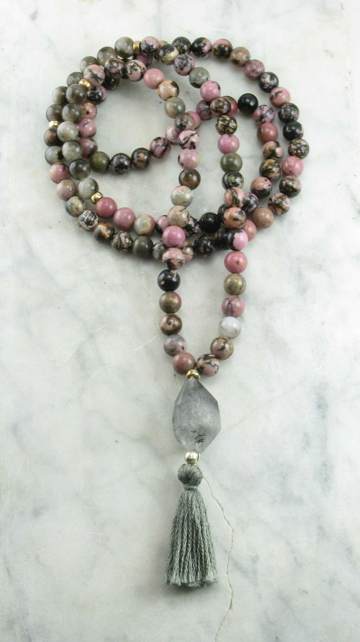 The Apprentice Mala is made from 108 rhodonite mala beads. It is completed with a Tibetan black quartz guru. Buddhist prayer beads for fulfilling destiny.