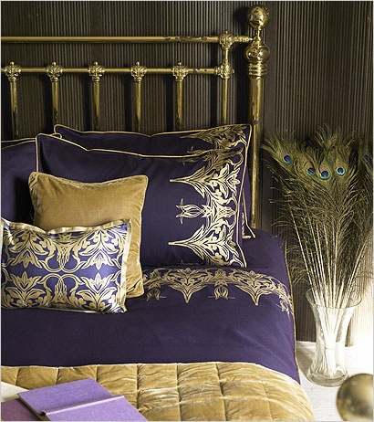Peacock feathers in purple & gold bedroom