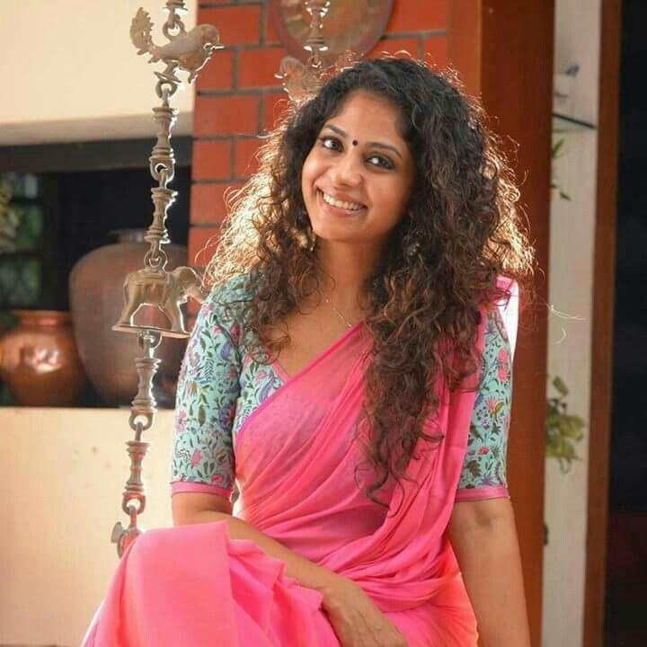 aasha sarath in floral blouse n plain saree