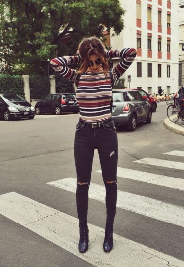 Stripes and ripped jeans.