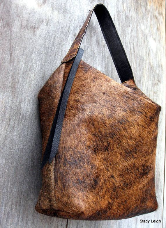 Black and Reddish Brown Brindle Hair On Cowhide by stacyleigh