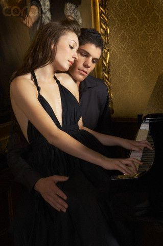 Romantic Young Couple Playing Piano