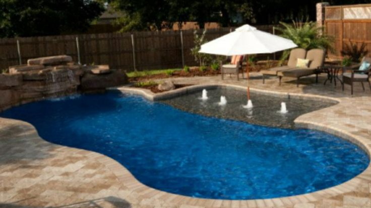 Fiberglass pool tanning ledge rock waterfall rico rock for Pool design with tanning ledge