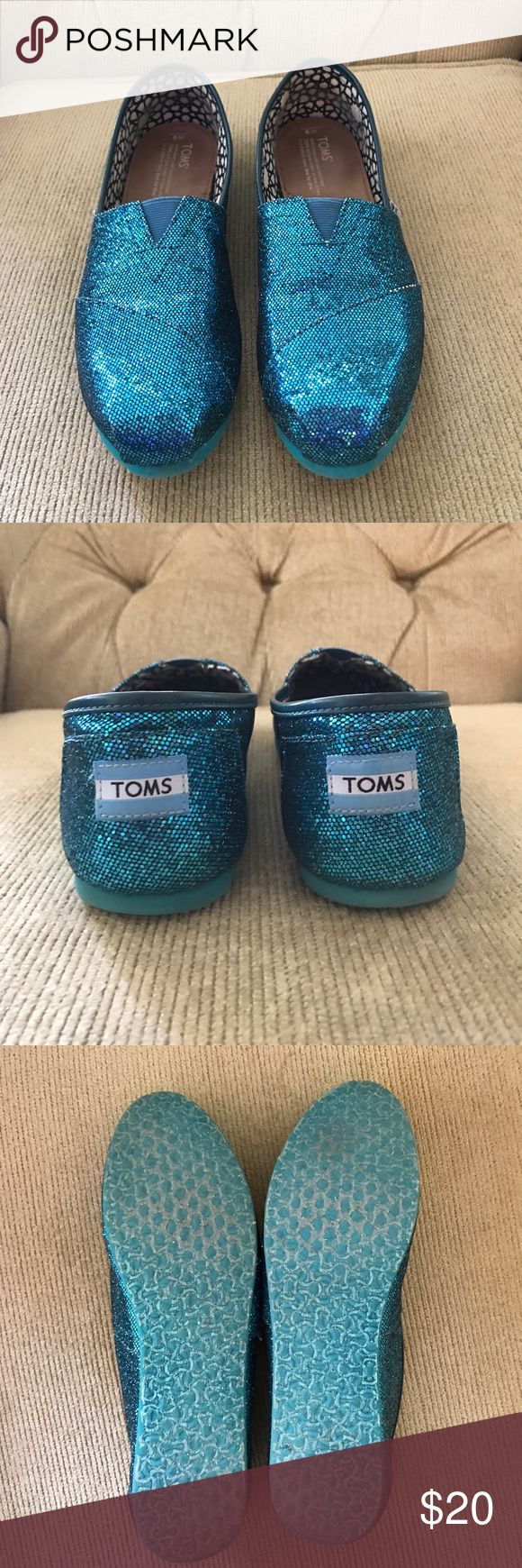 """TOMS Glitter classics, size 9. Great condition. TOMS Glitter classics, size 9. Great condition. Box included. Box says the color is """"emerald glitters"""" but I'd call the color teal or turquoise. Some of the glittery color is missing in places where the material is folded. (see photo) This is how they came when they were new, and is not due to wear. Shoes Flats & Loafers"""
