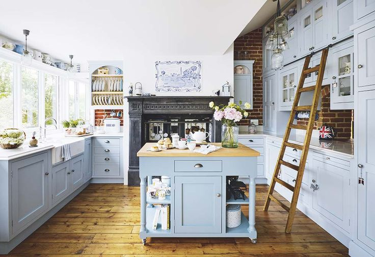 This bespoke kitchen features a converted Victorian range