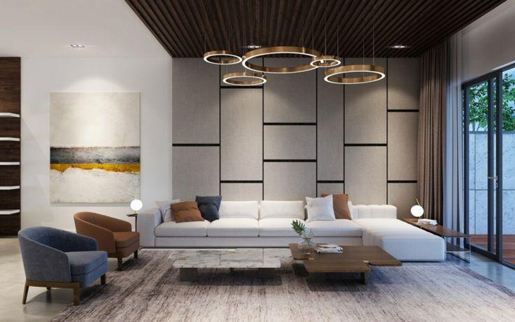 Soggiorno con un divano bianco e pavimento in legno ...