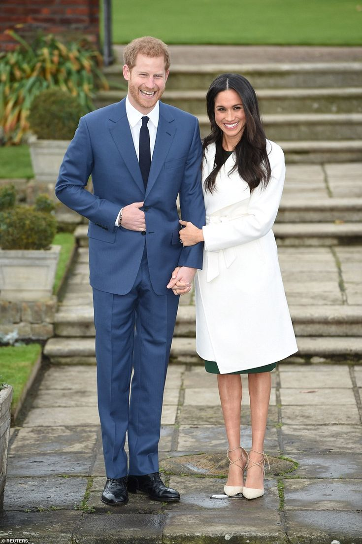Meghan put her hand on the arm of her husband-to-be, and radiated happiness as they excite...