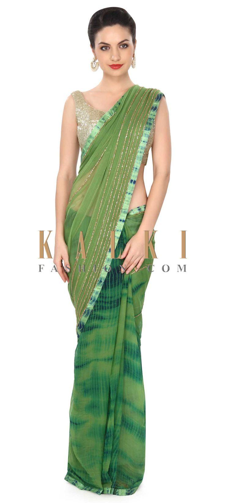 Buy this Green saree adorn in batik print and kardana work only on Kalki