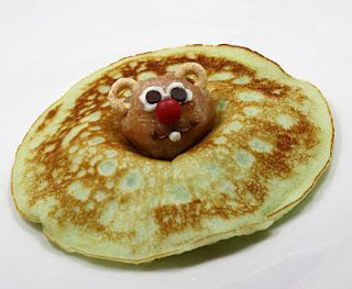 Groundhog day pancakes...     Use a donut hole for head, Cherrios for ears, use white icing and mini chocolate chips for eyes, mini red M nose.