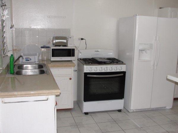 Kitchen, 3 Bedroom Upper Apartment To Rent In Atlantic Shores, Christ Church.  $180