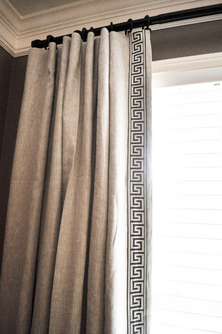Drapery Panels on rings and drapery rod. This also has a decorative fabric tape sewn to leading edge.