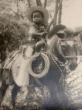 This little boy and cute pony are truly dressed to the nines.