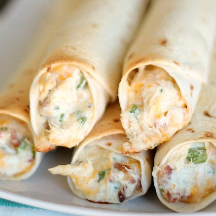 Baked Chicken Taquitos Recipe 1 (8 ounce) pkg. cream cheese 12 slices of bacon, cooked and crumbled 4 cups cooked, shredded chicken 1 (1 ounce) pkt. dry Ranch Dressing mix 2 cups shredded Monterrey Jack cheese 3-4 Tablespoons green onion, chopped 20 (6-inch) flour tortillas Salt, to taste Nonstick cooking spray