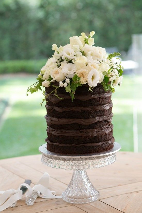Tall Chocolate Wedding Cake with Floral arrangement topper |