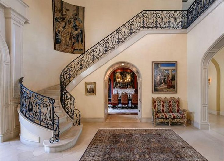 Foyer W/ Marble And Iron Staircase