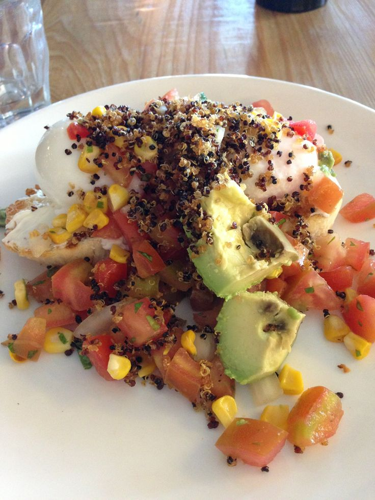 Brunch- quinoa, avo, tomatoes, corn and poach eggs on toast.