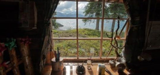 View of the lake from the writing desk of Dick Proenneke's Alaskan cabin.