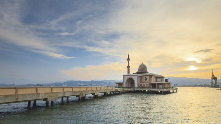 Beautiful Sunset Timelapse of Floating Mosque located at Penang Port, Butterworth, Penang, Malaysia. 4K. Motion Time lapse Zoom Out.