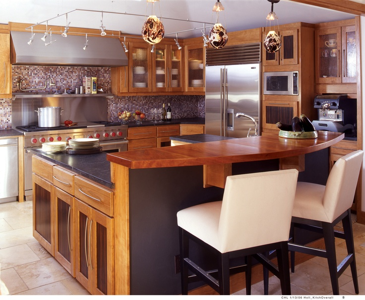 Andrea Schumacher Interiors Designs This Warm, Modern Kitchen Mixing Wood  And Stainless.