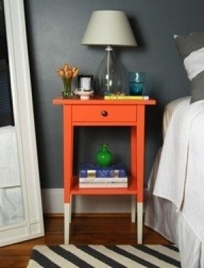 The nightstand adds a fun pop of color to the otherwise gray and white room.