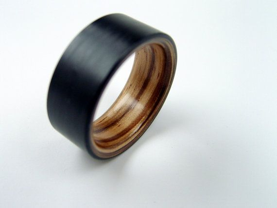 This is my favorite, but I like expensive things :(   Bent Wood and Carbon Fiber Ring  Zebrawood interior by hersteller, $179.00