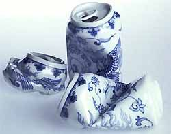 three Delft ceramic versions of crushed drink cans