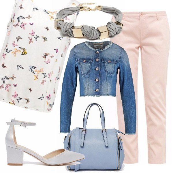 Pantaloni a sigaretta rosa chiaro, top fantasia con farfalle colorate, scarpa con leggero tacco argentata, giubbino jeans, collana azzurra e oro e borsa a mano azzurra.