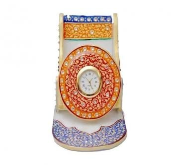 Decorative marble mobile stand with Watch made by the expert artisans is an exclusive item for gift as well as home decor purposes.This item is a complete utility product and gives a classical touch.
