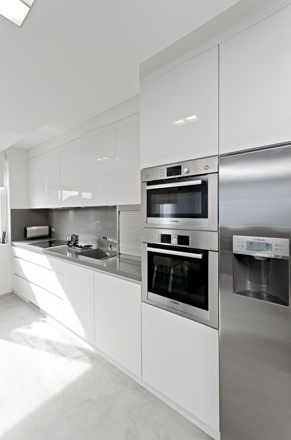 Get a white glossy kitchen with RAUVISIO brilliant high-gloss acrylic laminate. Like the tambour door as well? Get it all from REHAU Cabinet Door Solutions. | https://www.rehau.com/us-en/furniture/cabinet-doors