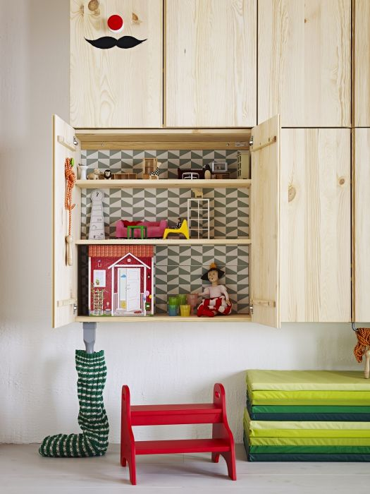 A wall cabinet (IVAR shown here) is a great place to hide away a DIY dollhouse!  The red TROGEN children's step stool will help little ones to reach.