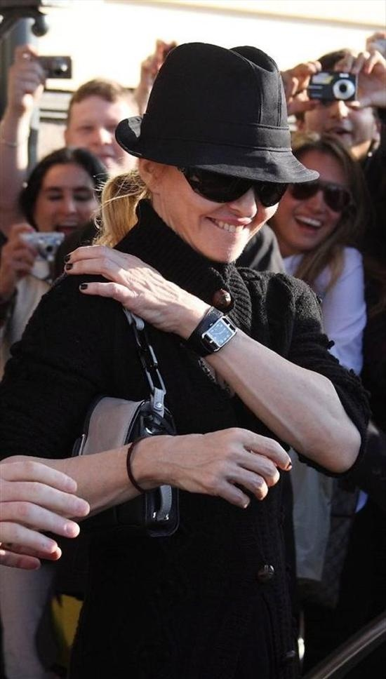 Madonna Ciccone wearing a Hermes Cape Cod watch ...