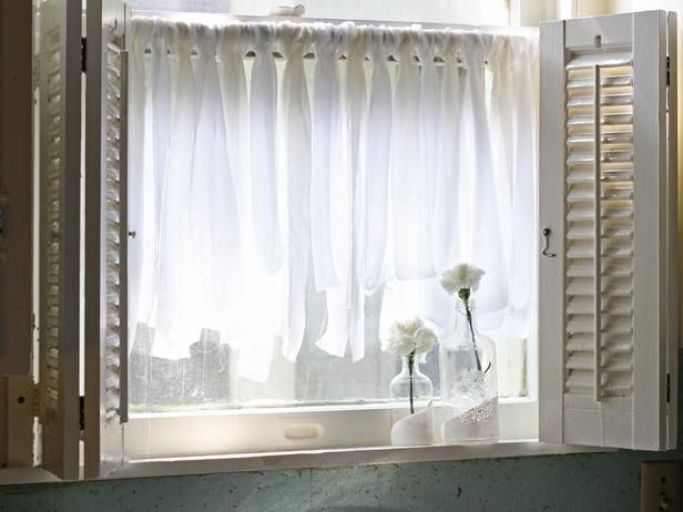 If you can tie a knot, then these flowy cafe curtains will be a breeze to make. This project only requires chiffon fabric, a curtain rod and scissors.