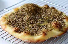Lebanese man'oushe, za'atar flatbread. I loveeee my Zaatar! Instead of homemade dough, I just use pillsbury grands! Roll them flat and then spread the zaatar mixture on the dough. Pair with Lebanese yogurt dip (salt and olive oil mixed in plain yogurt) and some jam to add a little sweetness.