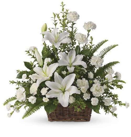 Peaceful white lilies basket basket flower arrangements